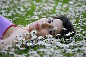 beautiful woman on white flower field.
