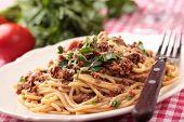 Spaghetti alla bolognese on a rustic table