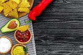 Popular Mexican Snack Nachos. Tiangle Nacho Tortilla Near Salsa And Guacamole Sause, Chili Pepper, S poster