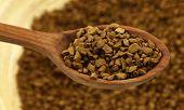 Coffee instant granules in wooden spoon