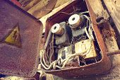 Overloaded Electrical Circuit Causing Electrical Short And Fire. Old Electric Power Supply Boxes. In poster
