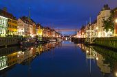 Panoramic View Of Nyhavn With Colorful Facades Of Old Houses And Old Ships In The Old Town Of Copenh poster