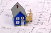 picture of home addition  - miniature house with addition and blueprints - JPG