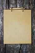 Grunge vintage old blank paper on wood wall.