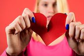 Blond Woman Tearing Heart In Half. Girl With Broken Heart. Female Hands Holds Ripped Paper Heart. Se poster