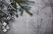 Dumbbell, fir tree branches, gifts and Christmas decorations  on a gray background. New Year and Chr poster
