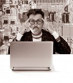 Nerd pensive man with myopic glasses looking for solution on electronics technology problem [ photo-