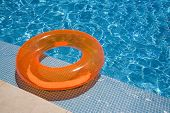 Orange Inflated Rubber Inflateble In The Pool