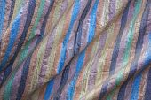 Blue Brown Black Yellow Green And Pink Stripes On The Rough Fabric With Folds. Rough Surface Texture poster
