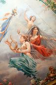 French paintings on theater ceiling in Cahors showing nude woman and french flag. republic symbol