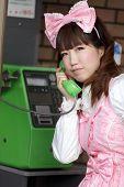 japanese girl in sweet lolita cosplay style phoning, Tokyo