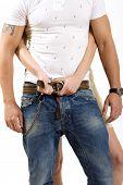 picture of a woman unbuckle  man's belt