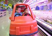 Children In Toy Automobile In Supermarket 3