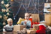 Child New Year. Kids Christmas. Children Playing With Gift. New Years Eve. Christmas Gift Box And Ha poster