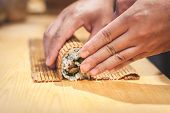 Preparation Sushi Roll In Restaurant, Close Up Chef Hands. Japanese Food. poster
