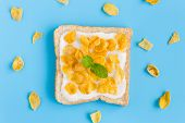 Cornflakes On Yogurt With Bread With Peppermint And Cornflakes On Blue Pastel Background Flatlay. Ce poster