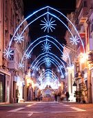 view of a illuminated street with christmas decoration in Valletta, Malta