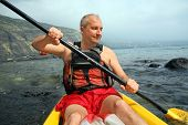 foto of mature men  - Mature man kayaking in the ocean on Big Island Hawaii - JPG