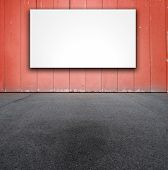 red wall with blank white board.