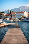 Wooden pier on the island of Hvar with mountain views
