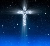 stock photo of starry night  - great glowing christian cross in starry night sky - JPG