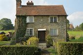 Stone Cottage In Country