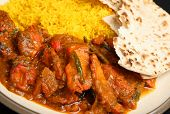 Indian chicken tikka jalfrezi curry with pilau rice and chapati.