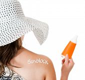 Summer woman wearing sunblock to protect her sking - isolated over white