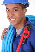 portrait of young black plumber
