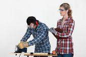 Woman supervising carpenter
