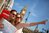 picture of lost love  - Couple of tourists in London holding a map - JPG