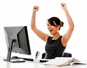 stock photo of win  - Successful business woman with arms up  - JPG