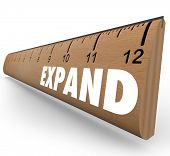 A wooden ruler with the word Expand to symbolize business expansion or growth of personal level or o
