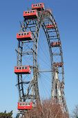 ferris wheel with red cabines in Prater park in Vienna, Austria