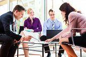 Business people having meeting or workshop in office