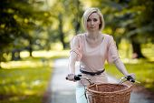 Female biker in a park