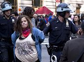NEW YORK - SEPT 17: An unidentified woman being arrested on the 1yr anniversary of the Occupy Wall S
