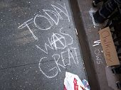 NEW YORK - SEPT 17:  'Today Was Great' is written in chalk on the sidewalk outside of Trinity Church on the 1yr anniversary of the Occupy Wall St protests on September 17, 2012 in New York City, NY.