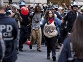 NEW YORK - SEPT 17: Two unidentified protesters being arrested on the 1yr anniversary of the Occupy Wall St protests on September 17, 2012 in New York City, NY.