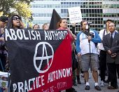 NEW YORK - SEPT 17: A protester shouts while holding a sign that reads 'Abolish Authority' on the 1y