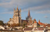 Sunset over ancient cathedral in Lausanne, dominating the cityscape