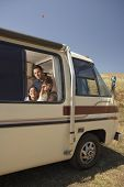 Family looking out of motorhome window