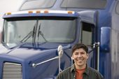 Man standing in front of truck
