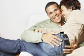 stock photo of lap  - Man holding his girlfriend on his lap - JPG