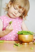 Girl Opens Peas