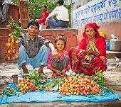 KATHMANDU, NEPAL - MAY 19: Family sell lychee fruits on a street market in Kathmandu on May 19, 2013