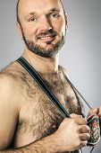 An image of a hairy man in bavarian tradition