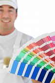 Male decorator holding paint swatch
