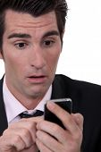 Businessman shocked by text message