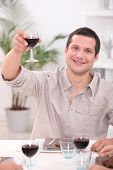 Man raising his glass for a toast